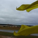 Two yellow flags in the wind.