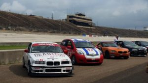 Cars lined up in pit lane at Texas World Speedway for the 2015 Memorial Weekend Grand Prix.