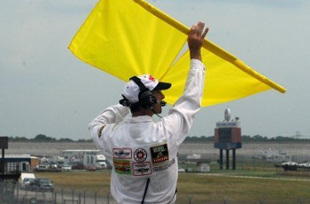 Double Yellow Flags held by Corner Worker